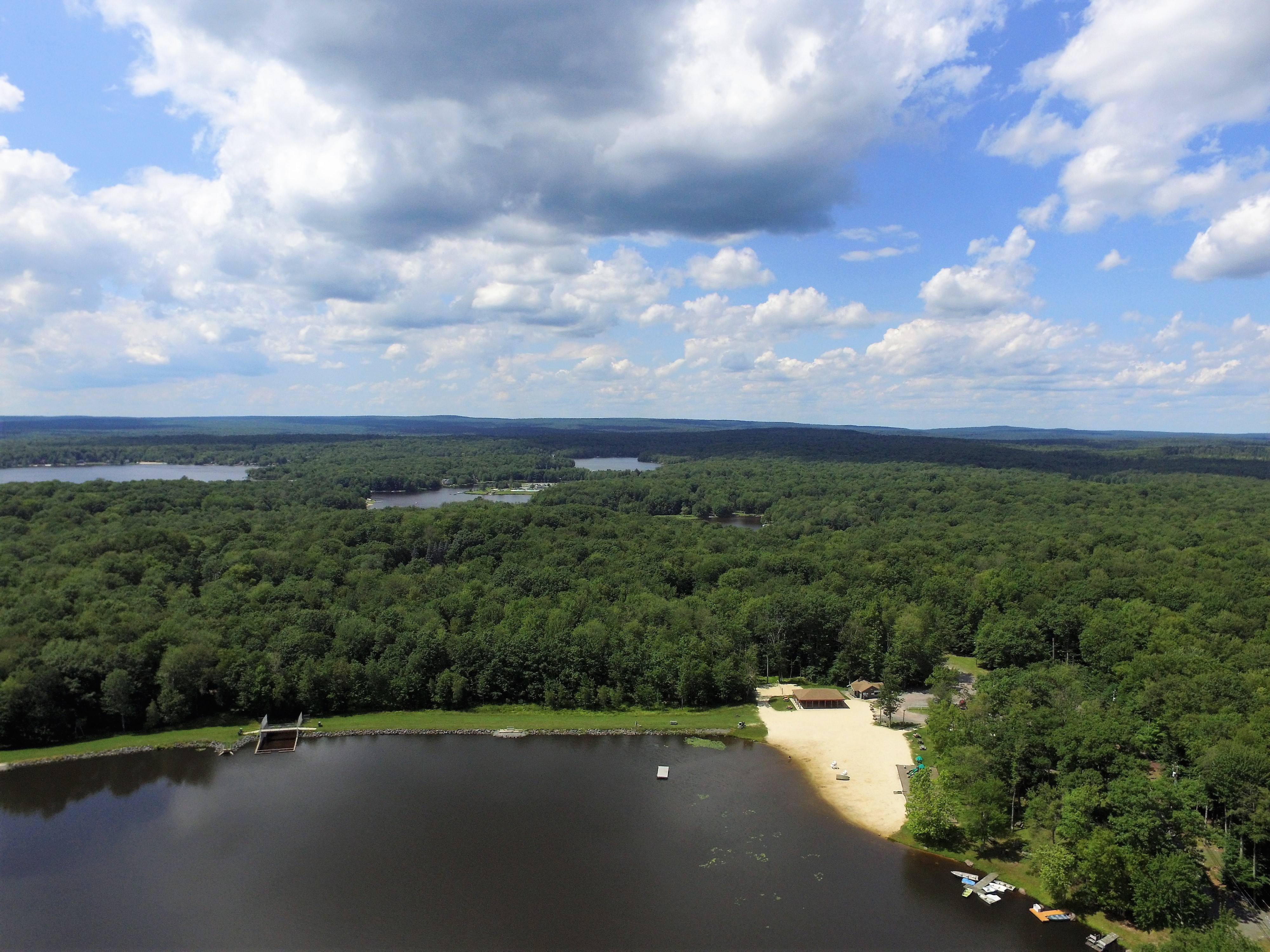 Flying over locust lake in pocono lake pa living pocono the pocono drone was a stranger to in the middle picture below you can actually see both of the lakes at arrowhead lakes beyond the trees there publicscrutiny Gallery